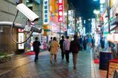 CCTV Camera or surveillance oeprating on street at night — Stock Photo