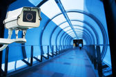 CCTV Camera or surveillance operating in blue walk way — Stock Photo