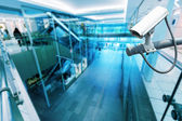 CCTV Camera or surveillance operating in building hightech blue  — Stock Photo