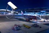 CCTV camera or surveillance operating in airport — Stock Photo
