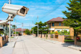 CCTV Camera with house and village in background — Stock Photo