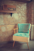 Armchair and old radio vintage retro style — Stock Photo
