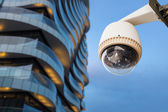 CCTV camera or surveillance operating outside office balcony — Stock Photo