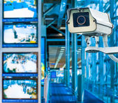 CCTV Camera or surveillance operating with monitor in background — Stock Photo
