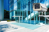 CCTV Camera or surveillance orperating with city building in bac — Stockfoto