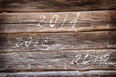 Year 2014 are coming - written on wooden background — Stock Photo