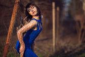 Beautiful girl in blue evening dress. — Stock Photo