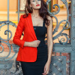 Girl in a red jacket with scarlet lips. — Stock Photo #46523397