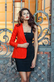 Girl in a red jacket with scarlet lips. — Stock Photo