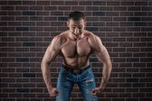 Bodybuilder growls menacingly. — Stock Photo