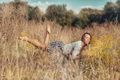 Girl flying over the meadow — Stock Photo