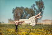 Girl hovers over the field. — Stock Photo