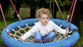 Young child playing on a swing — Stock Photo