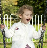 Young child on a swing — Stock Photo