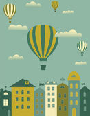 Hot air balloons flying over the town — Stock vektor