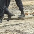 Stock Video: Military forces boots step over dirt