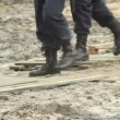 Stock Video: Military soldiers massive boots in dirt