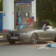 Blonde in elite car at gas station — Stock Video #38723837