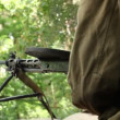 Vintage machine gun spits out series of bullet — Stock Video #38725073