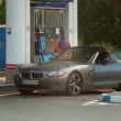 Stock Video: Elite car drives to gas fueling station