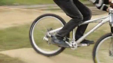 BMX racer rides circuit competition against opponent, bicycle — Stock Video