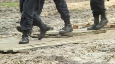 Military forces boots step over dirt — Stock Video