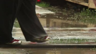People legs walking on puddles climate change — Stock Video