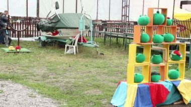 Children toss bird pile of toys — Stock Video