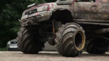 Moving large big-foot vehicle completely in mud and dirt wheels — Stock Video