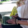 Woman in park typing message — Stock Video