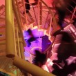 People walking up and down steel winding staircase — Stock video #39637057