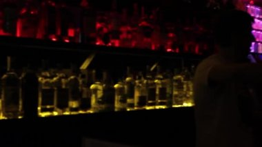 Blurry view of night club's bar — Stock Video