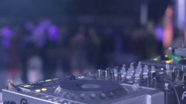 DJ at his deck controlling sound — Stock Video
