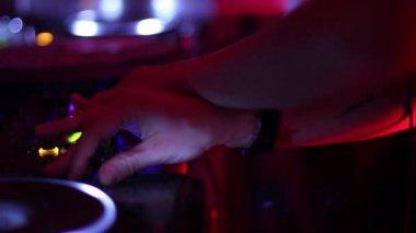 Female dj hands crossed tweaking mixer controls — Stock Video