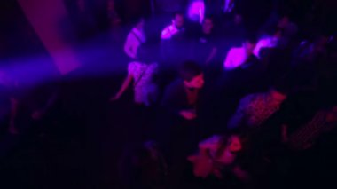 Overhead jib shot of night club people dancing — Stock Video