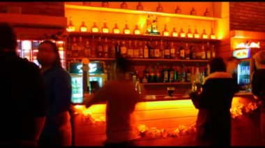 Timelapse of people behind the bar — Stock Video