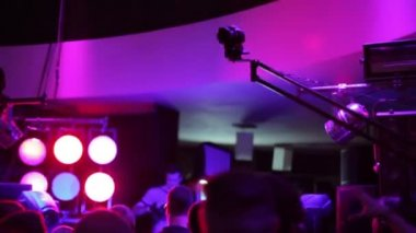 Jib crane DSLR camera operating on dance floor — Stock Video