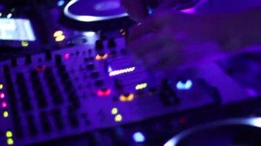 Hands of DJ tweak various track controls on dj's deck — Stock Video