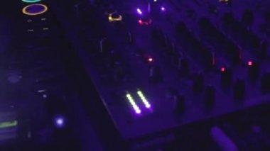 Hands of DJ move mixer controls — Stock Video