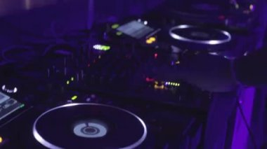 Dj makes moves with hands playing set of music in nightclub — Stock Video