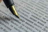 Writing elite pen macro on white A4 document signing contract — Stock Photo