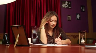 Businesswoman signing documents in her office — Stock Video