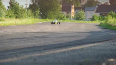 Two f1 race cars driving at low speed — Stock Video