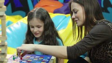 Girl playing board game — Stock Video