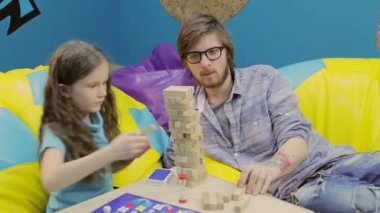 Brother helping his sister to build tower — Stock Video