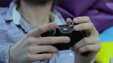 Man pushes joystick buttons — Stockvideo