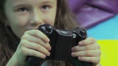 Excited girl playing console game — Stock Video