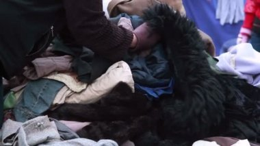 Clothes pile for poor people in winter — Vidéo