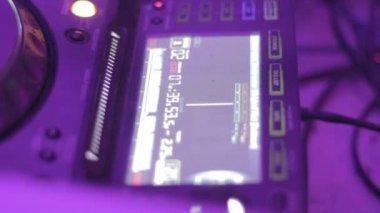 Dj playing mix in nightclub, hands tweaking controls — Stock Video