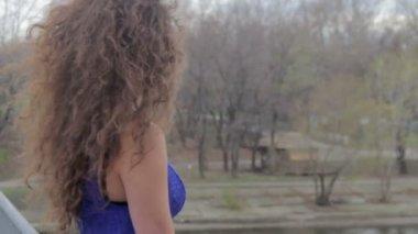Lonely female on bridge — Stock Video